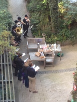 A brass band for someone's birthday in our courtyard, at 7am