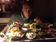 Alex digs in to the feast at Puk